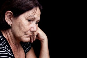 sad and worried older woman