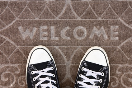 Welcome carpet with foot-ware on it