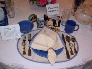A formal-looking place setting at a banquet table