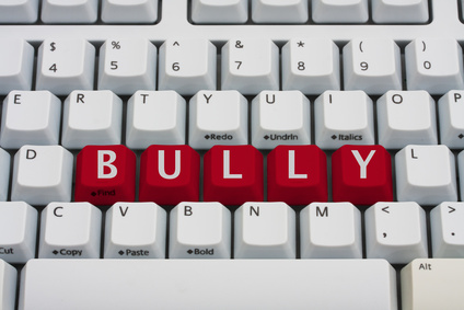 Computer keyboard key displaying word bully, Bullying on the Internet