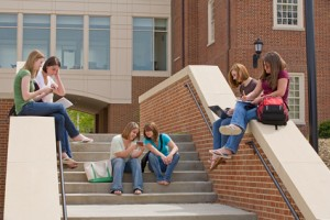 students on steps in front of school building
